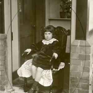G36-009-10 Girl sitting posed in porch.jpg