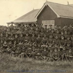 Royal Berkshire Regiment; a group of men outside a building clad in corrugated iron, early twentieth century