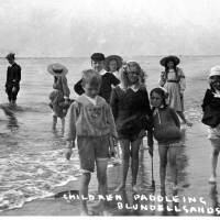Blundellsands beach young People Paddling