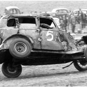 A car overturning at a motor rally event.