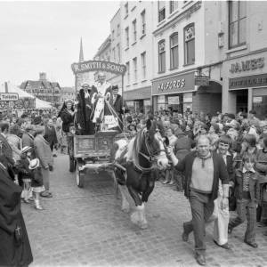 Crowds watching the  civic parade through High Town, Hereford for the opening of the May Fair in 1975.
