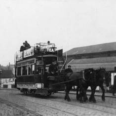 Double deck horse drawn tram