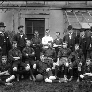 G36-406-11 Football team with officials.jpg