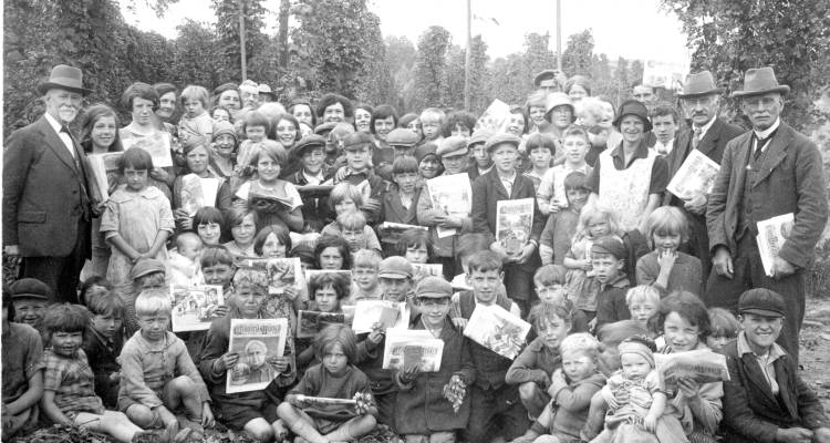 Hop picking, children holding copies of the 'Christian Herald'