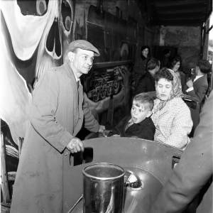 A woman and child on Albert Barton's Ghost Train at the May Fair, Hereford, 1964.