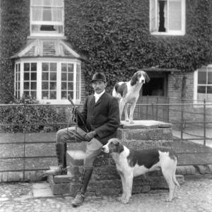 G36-251-09 Same young man as G36-251-02 and 07, seated on mounting block with the 2 dogs.jpg