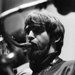 075 - Bearded man playing sax.