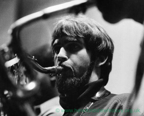 075 - Bearded man playing sax.