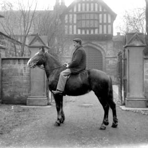 G36-322-12 Man seated on horse outside Bishops Palace.jpg