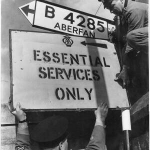 350 - Two AA patrolmen erecting sign for 'Essential Services Only'