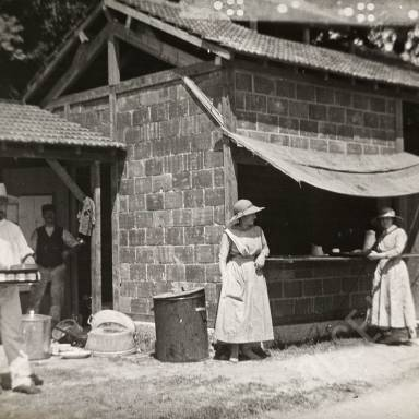 Orderlies and Civilians at Outdoor Kitchen