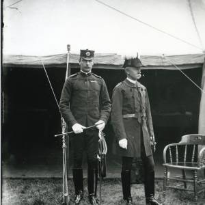G36-028-05 Two uniformed soldiers in front of tent. One with plumed helmet, one with swagger cane .jpg