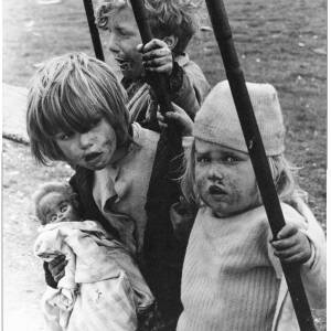 353 - Three children, one with a doll