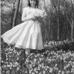 192 - Young girl (Jane Hancocks) holding bunch of daffodils