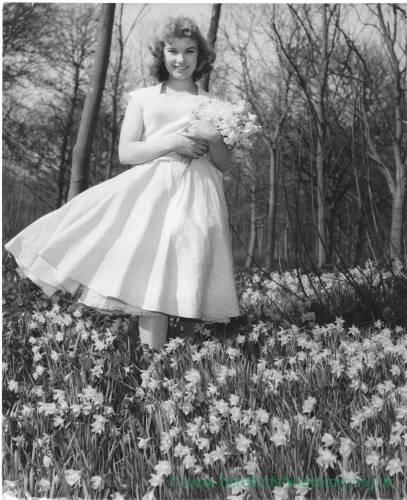 192 - Young girl (Jane Hancocks) holding bunch of daffodils