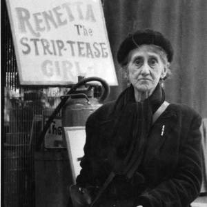 Lady posing in front of 'Renetta The Strip-Tease Girl' May Fair stall - undated.