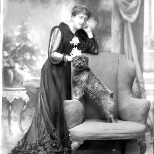G36-172-06 Portrait of lady standing with dog on chair.jpg