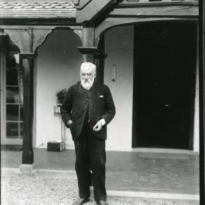 G36-002-02 Old man with beard standing in front of Field Farm House Hampton Bishop.jpg