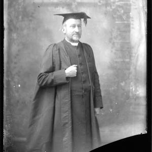 G36-120-15 Portrait of clergyman from G36-120-15 now wearing cap and gown.jpg