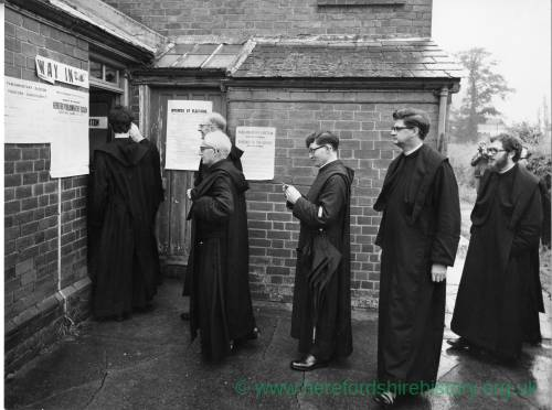 Benedictine Monks from Belmont Abbey file into polling station