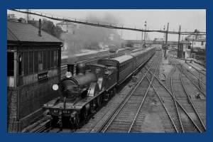 Train passing the Wimbledon 'D' signalbox, Wimbledon Station
