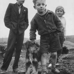 Children with a small dog