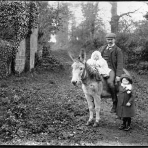 G36-051-12  Man with baby on donkey and small girl.jpg