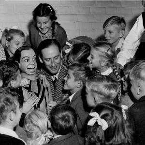 150 - Peter Brough & puppet Archie Andrews with group of children