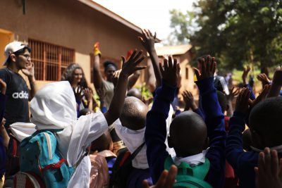school_children_jumping_in_camps_after_projects