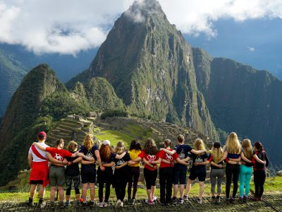 Students stood in front of a mountain