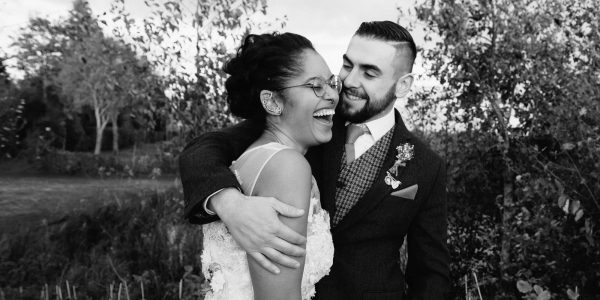 candid photograph of a laughing bride and groom at their wedding at South Farm