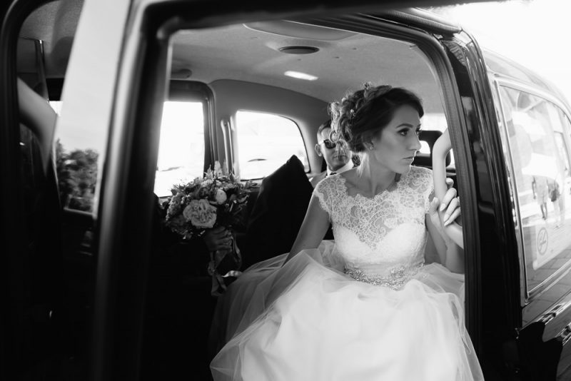 Bride waiting in a London Taxi before going into her wedding