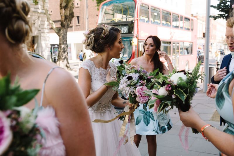 A bride and her friends bridesmaids and her best gay friend are waiting to go into Chelsea Town Hall