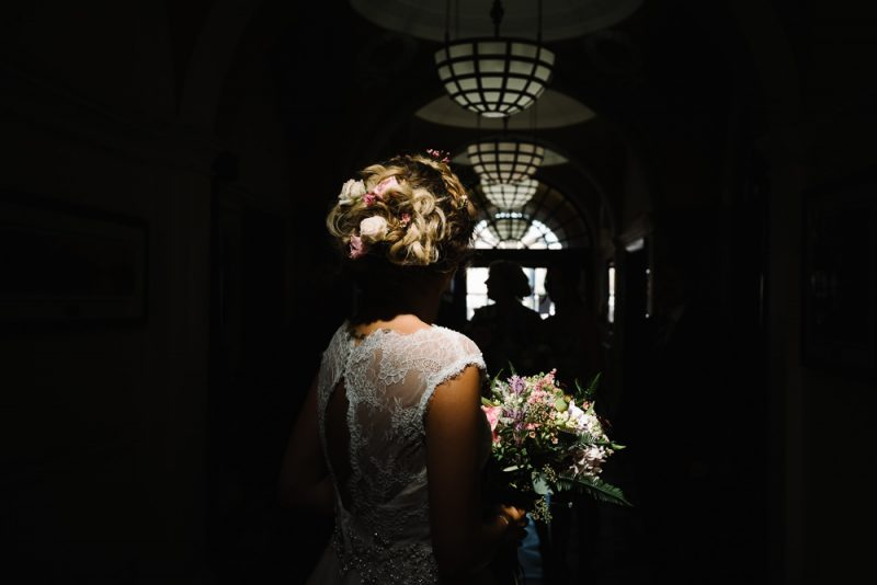 a documentary image of a bride holding her bouquet inside at Chelsea Town Hall