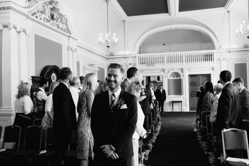 Groom waiting for his partner to walk down the aisle