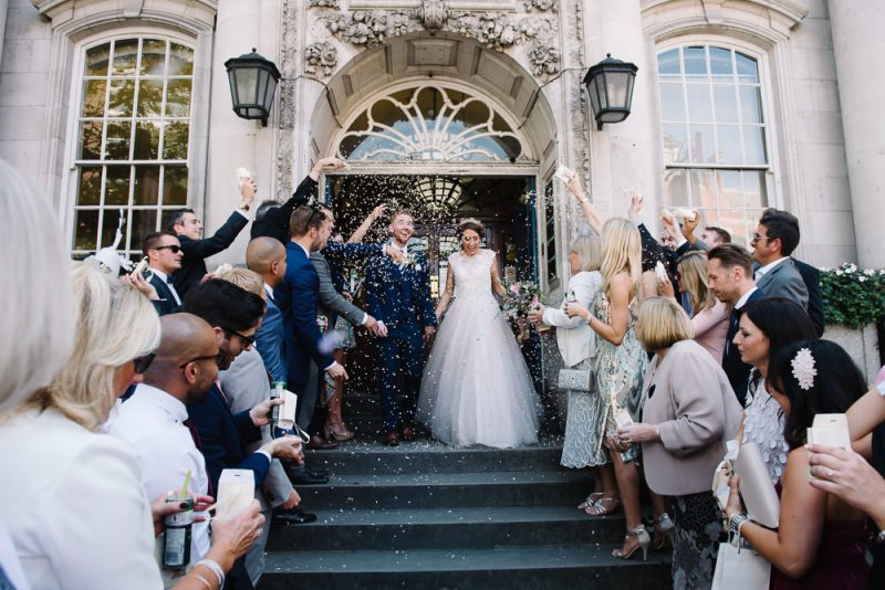 newly married couple on the steps of Chelsea town hall