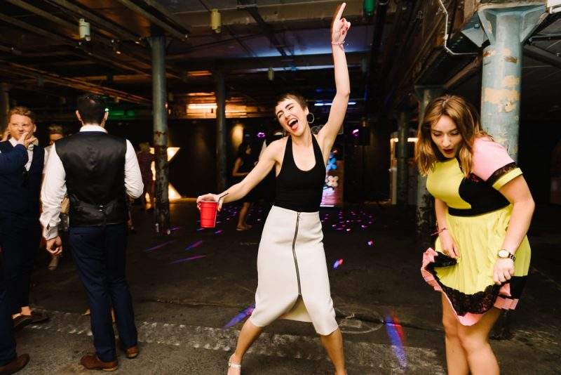 wedding guest is dancing in a warehouse