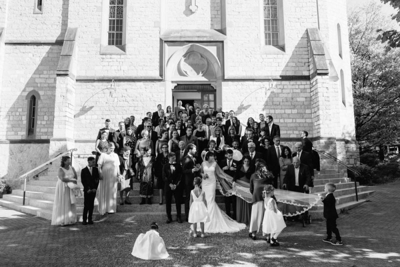 Group wedding photograph on the Steps of Binnigham Church, Basel