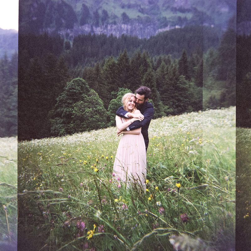 couple embrace on their Swiss mountain elopement