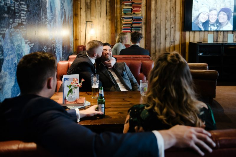 Wedding guests are sitting in a pub at an alternative wedding