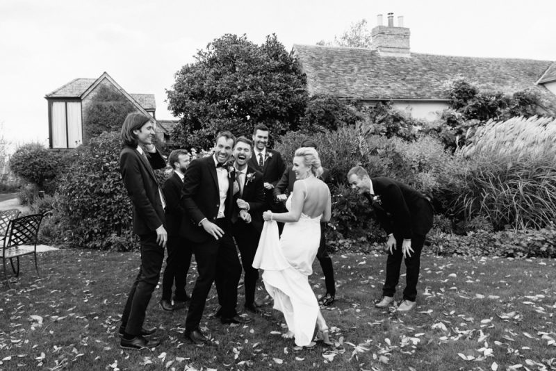 Group photo out-take. Everyone is laughing, its a London wedding