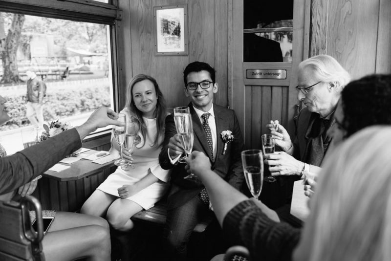 champagne toast at a wedding in an old timer tram in Zurich, Switzerland