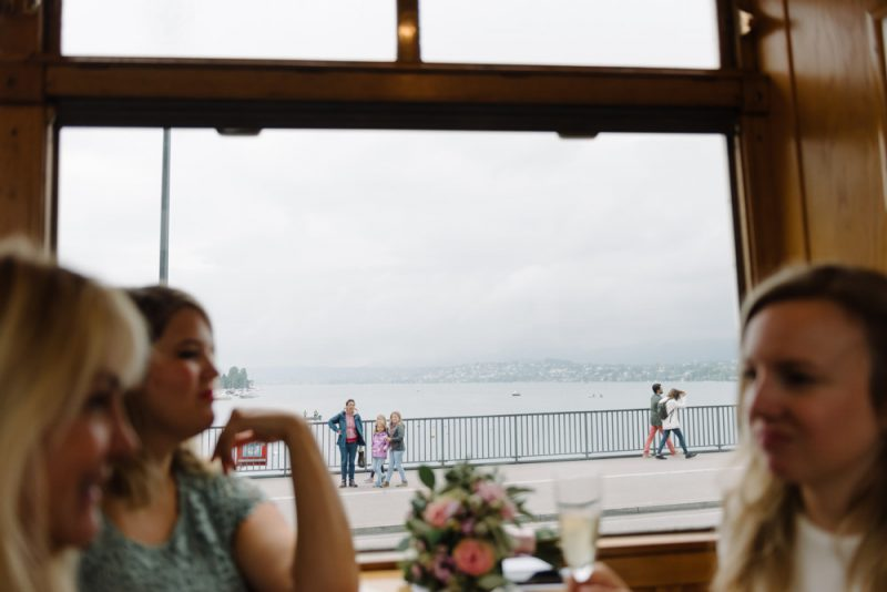 Lake Zurich through the window of an old fashioned tram at a wedding