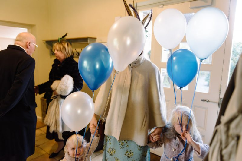 unhappy little girls at a wedding with balloons