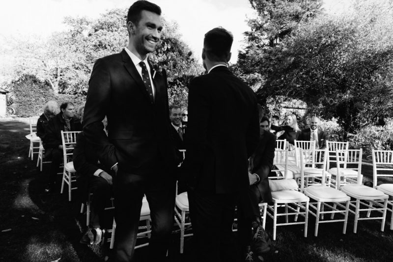 groom and best man smiling before the wedding