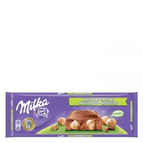 Milka chocolate con avellanas enteras tableta de 300g.