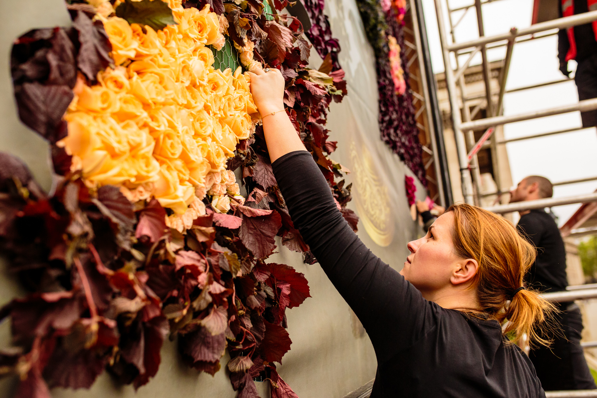 Finishing touches added to the installation by the florists