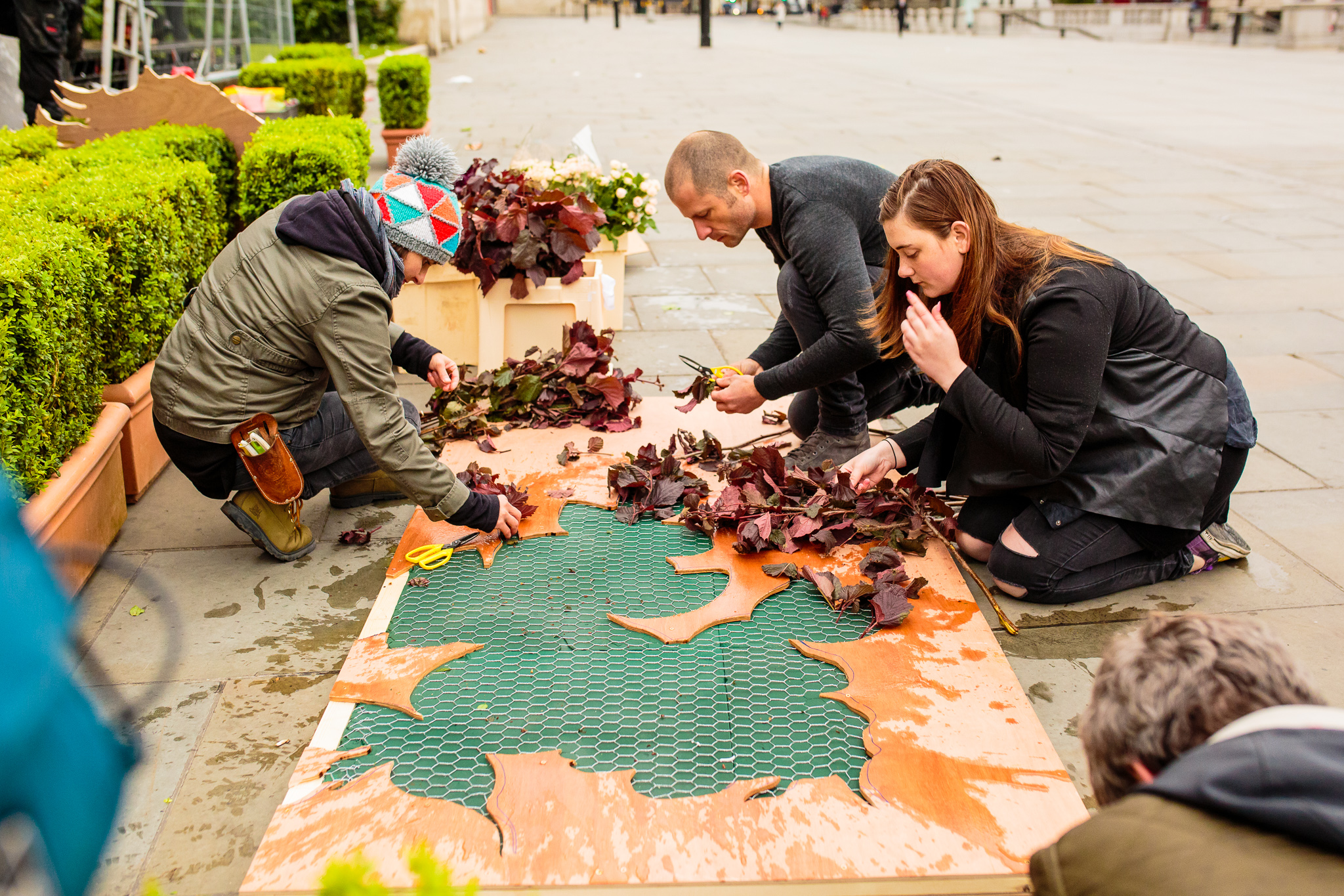 Florists working on the final panels