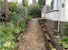 Hard landscape, sleeper steps and paving.