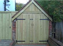Fitted new garage door frame and new tongue and groove cladding to gable end of garage, supplied and